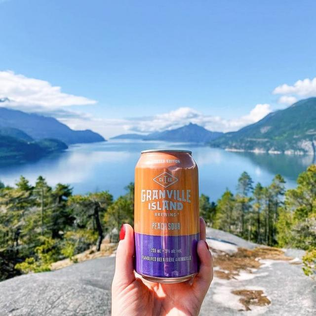 The perfect shot of our new sweet and tangy Peach Sour fully engrossed in nature doesn't exi- 🍻 🍑 🏞  📸 : @galswhocan . . . #gib #granvilleisland #loca